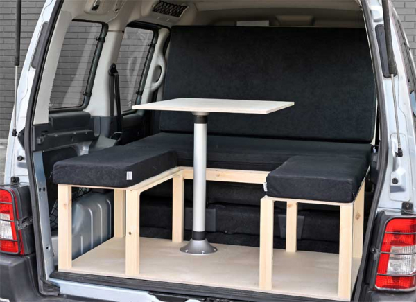 The Simple camper van conversion in seating mode with the optional cushion set.