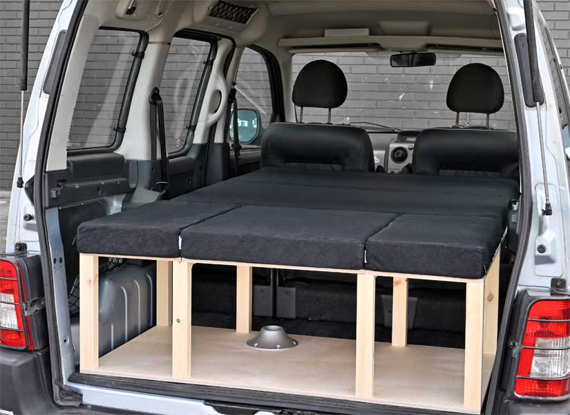 The Simple camper van conversion in sleeping mode with the optional cushion set.