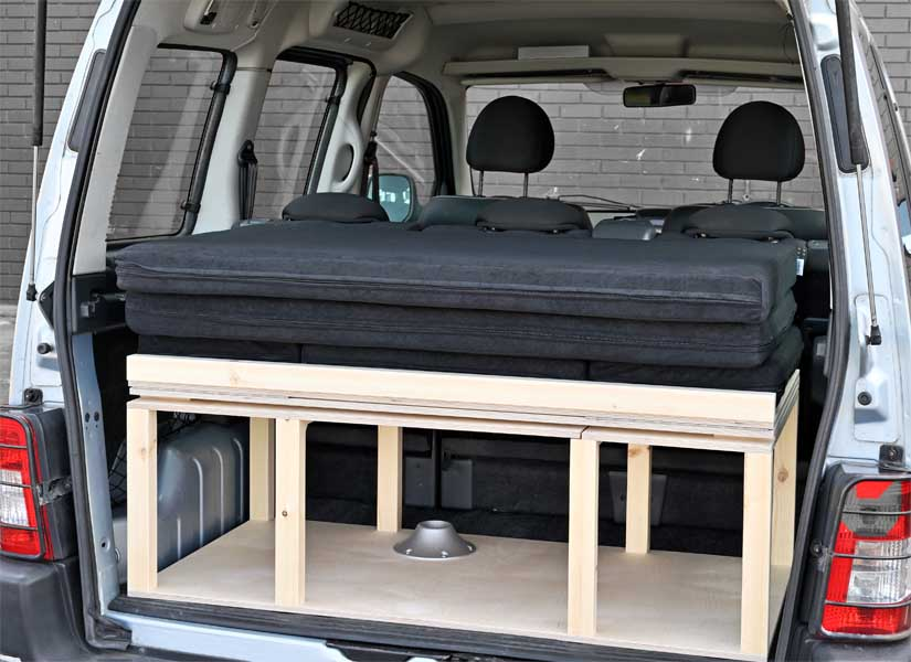 The Simple camper van conversion in storage mode with the optional cushion set.