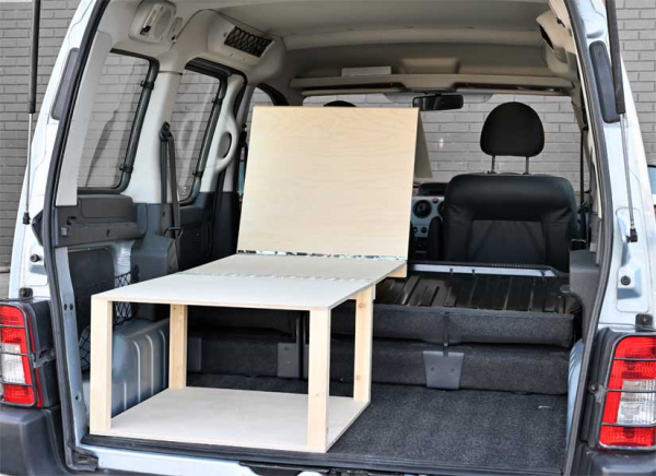 The Simple Solo camper van conversion in seating mode.