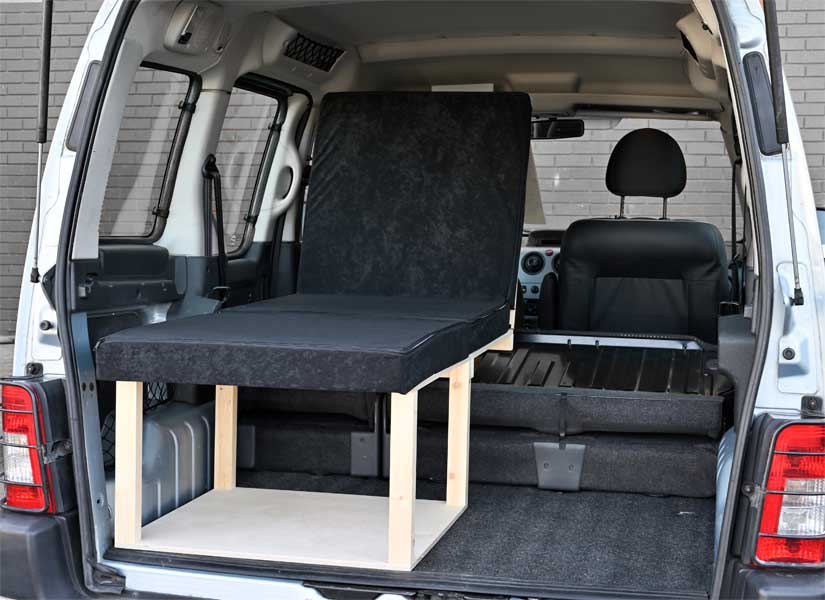 The Simple Solo camper van conversion in seating mode with the optional cushion set.