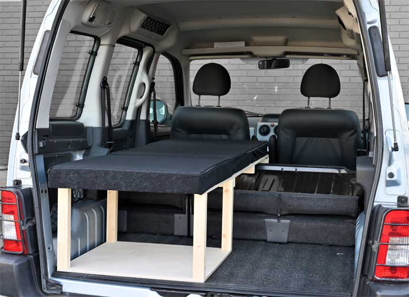 The Simple Solo camper van conversion in sleeping mode with the optional cushion set.