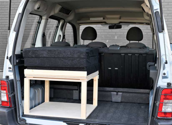 The Simple Solo camper van conversion in storage mode with the optional cushion set.