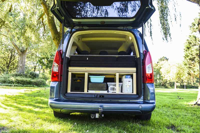 The camper van module neatly folds into the boot of your car when not in use.