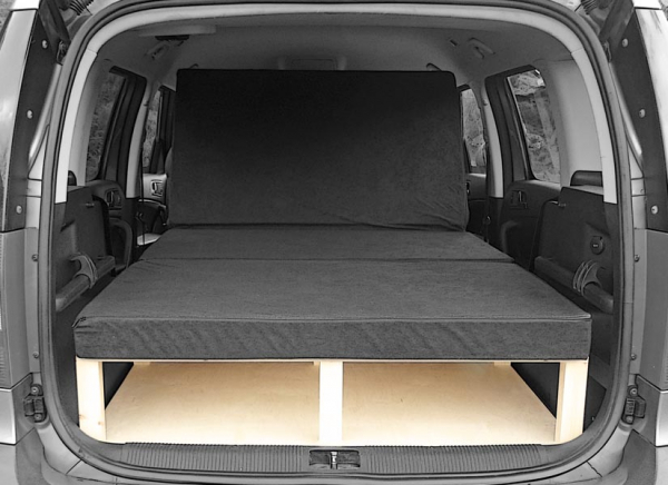 The Skoda Roomster camper van conversion in seating mode with the optional cushion set.