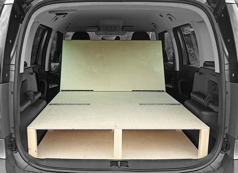 The Skoda Roomster camper van conversion in seating mode mode.