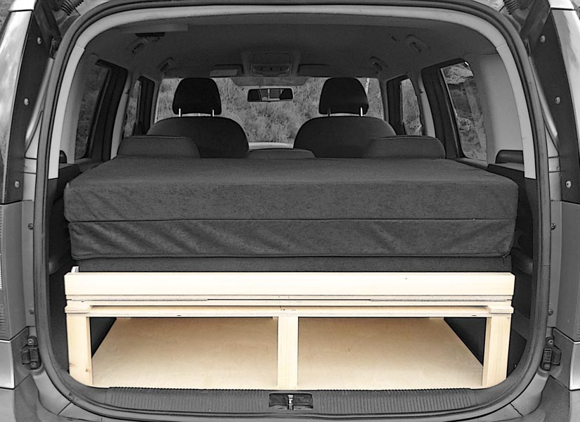 The Skoda Roomster camper van conversion in storage mode with the optional cushion set.
