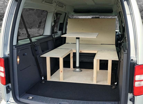 The VW Caddy Maxi Life camper van conversion in seating mode.