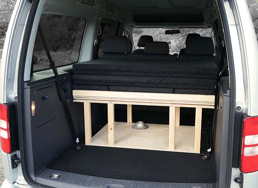 The VW Caddy Maxi Life camper van conversion in storage mode with the optional cushion set.