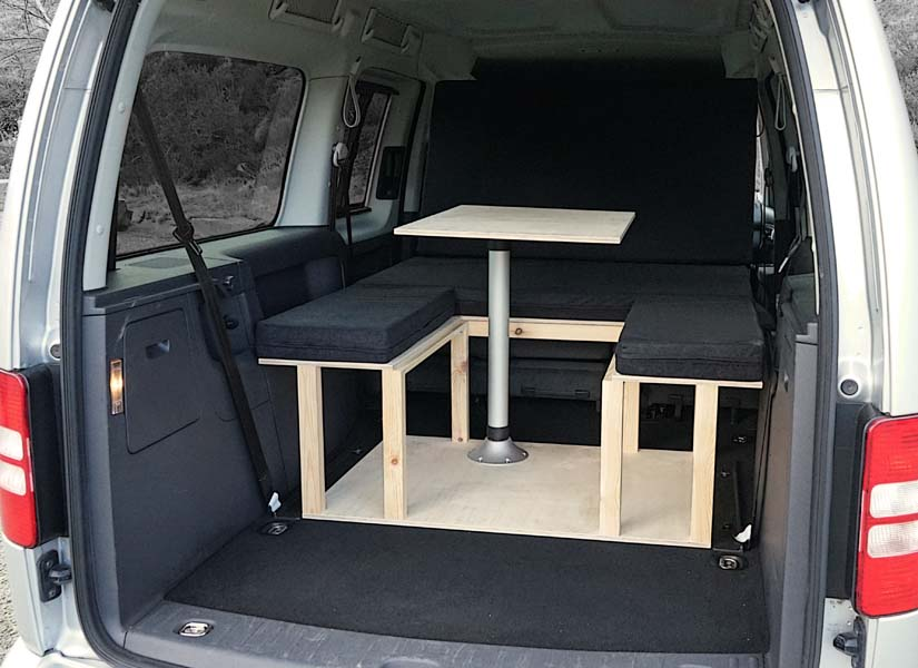 The VW Caddy Maxi Life camper van conversion in seating mode with the optional cushion set.